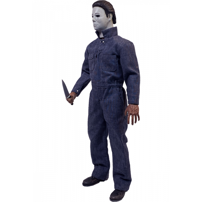 This is a Halloween 4 Return of Michael Myers Trick Or Treat Action Figure and he has a white mask, blue coveralls, black boots and a silver knife.