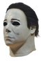 This is a Halloween 4 Return of Michael Myers mask that has a white face, ears and neck, with dark brown hair and black eyes.