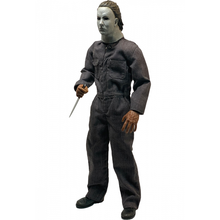 This is a Halloween 5 Revenge of Michael Myers Trick Or Treat Action Figure and he has a white mask, grey coveralls, black boots and a silver knife.