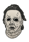 This is a Michael Myers enamel pin from Halloween 6 and it is a white face with brown hair and black eyes.