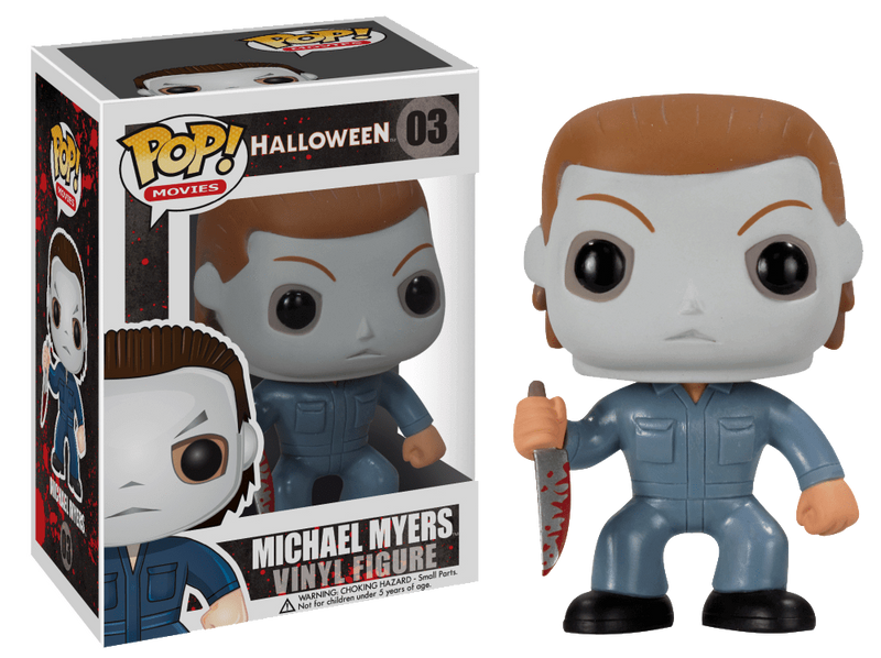 This is a Halloween Michael Myers Funko pop and he has a white face, blue coveralls and is holding a bloody knife in his hand.