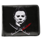 This is a Halloween Michael Myers wallet that is black with a white face and bloody crossed knives.