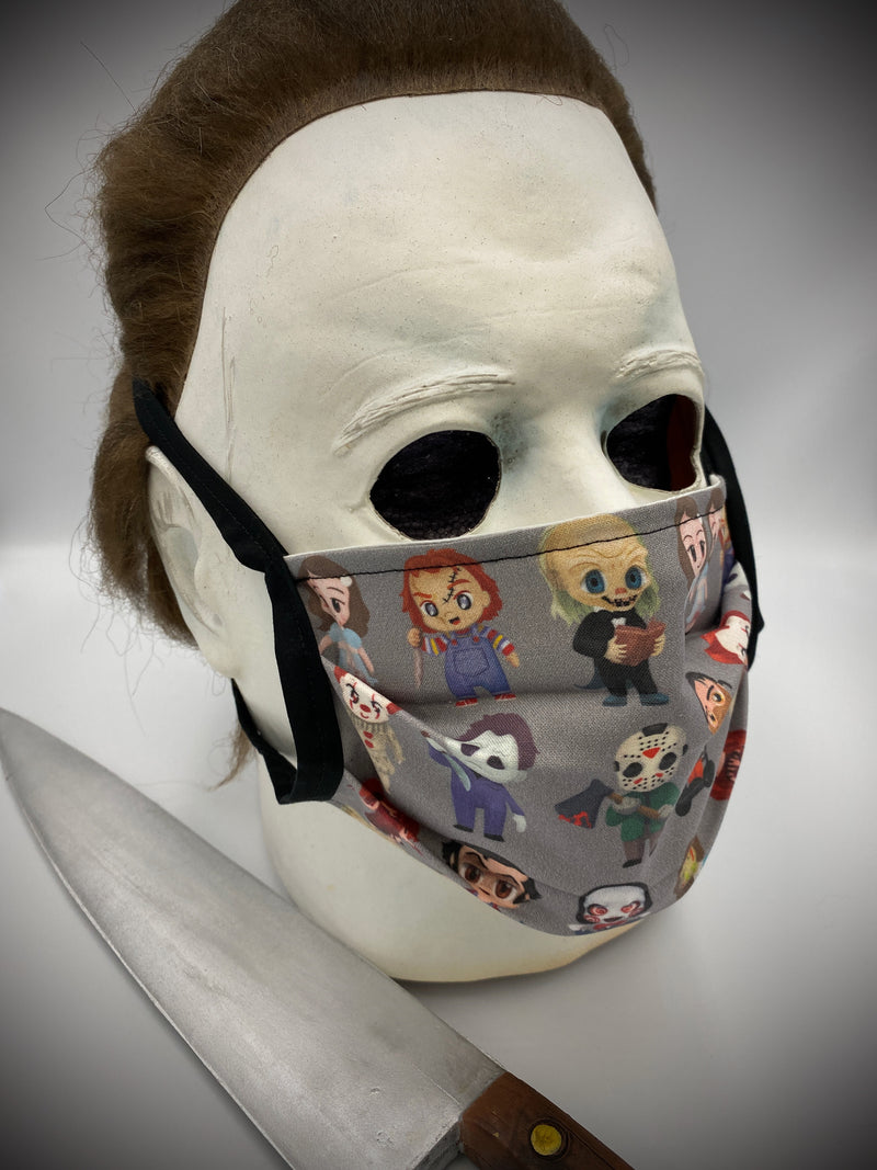 These are horror characters on a grey protective face mask with black ties and has the characters from Saw, Exorcist, Carrie, The Shining, It, Child's Play, Friday the 13th and Halloween.