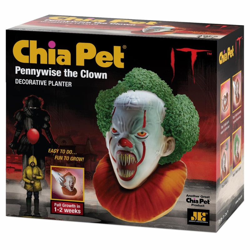 This is an It Movie Pennywise the Dancing Clown Chia Pet and he has a white face, pointy teeth and a green plant growing out of his head.