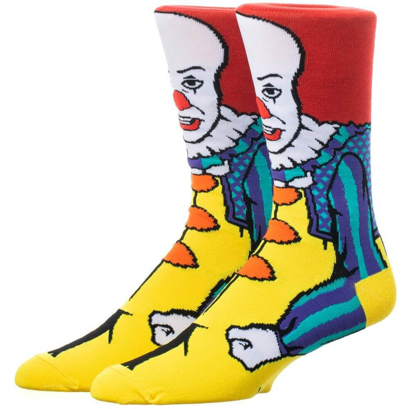 This is a pair of It 1990 Pennywise crew socks and he has red hair, a red nose, yellow clown suit and they are printed 360.