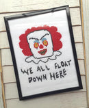 This is a Pennywise the clown It Movie DIY cross stitch kit and he has red hair, yellow eyes, white collar and it says we all float down here.