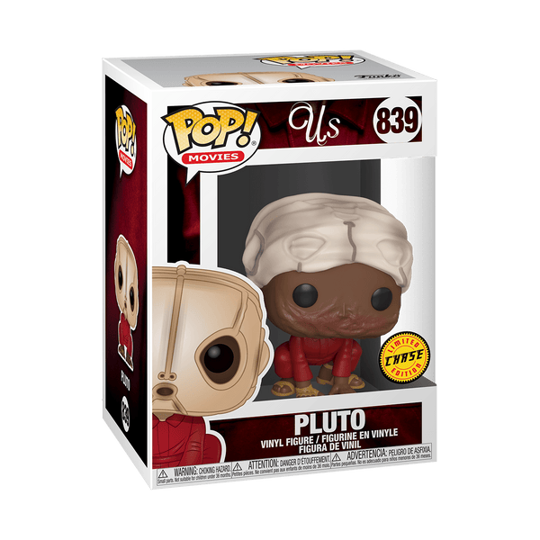 This is a Jordan Peele Us Movie Pluto Chase Pop Vinyl Funko and he is wearing a red jumpsuit with a tan mask and is crouched down on his hands and knees with his burnt face showing.