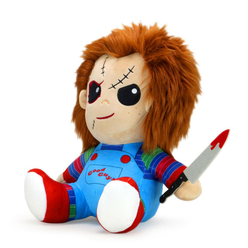 This is a Child's Play Chucky Kidrobot HugMe vibrating plush and he has a striped shirt, red shoes, orange hair, black eyes and is holding a bloody silver knife with a black handle.