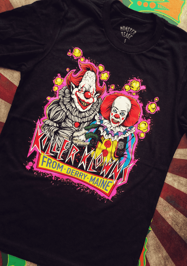 This is a Killer Klowns From Outer Space t-shirt and it has two clowns with red hair and noses and popcorn.