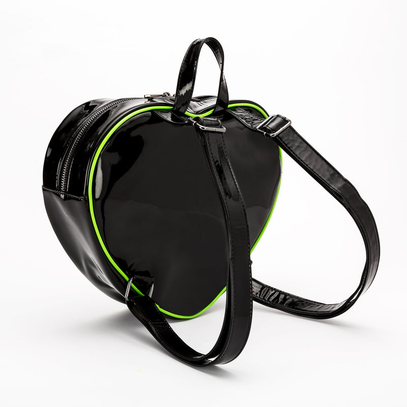 This is a Lily Munster heart shaped backpack purse and it has green piping and two black shoulder straps.
