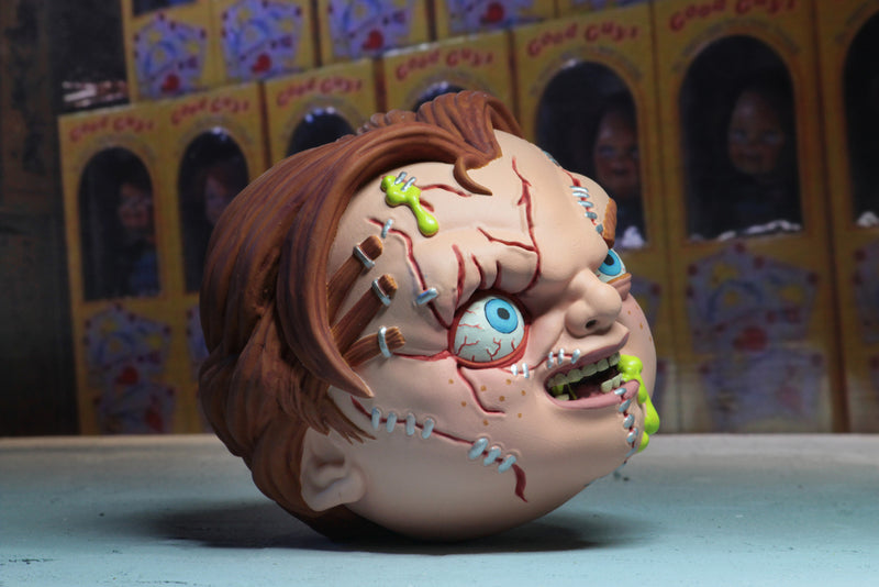 Chucky has red hair, scars on his face, his head is a Horrorball and he has green stuff coming out of his foam head.