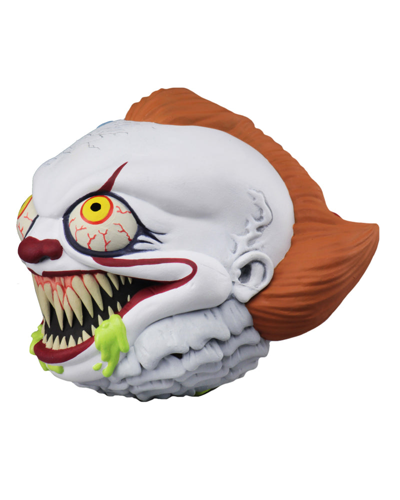 Pennywise the clown from the It movie Madball has green goo coming out of his mouth, that is showing his fang teeth, below his orange hair.