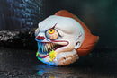 Pennywise the clown from the It movie 4 inch ball has green goo coming out of his mouth, that is showing his fang teeth, below his orange hair..