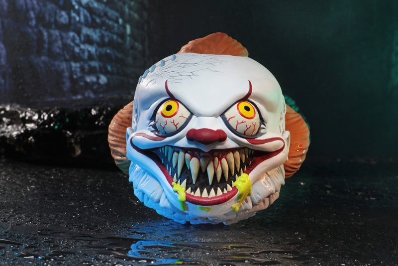 Pennywise the clown from the It movie foam ball has green goo coming out of his mouth, that is showing his fang teeth, below his orange hair..