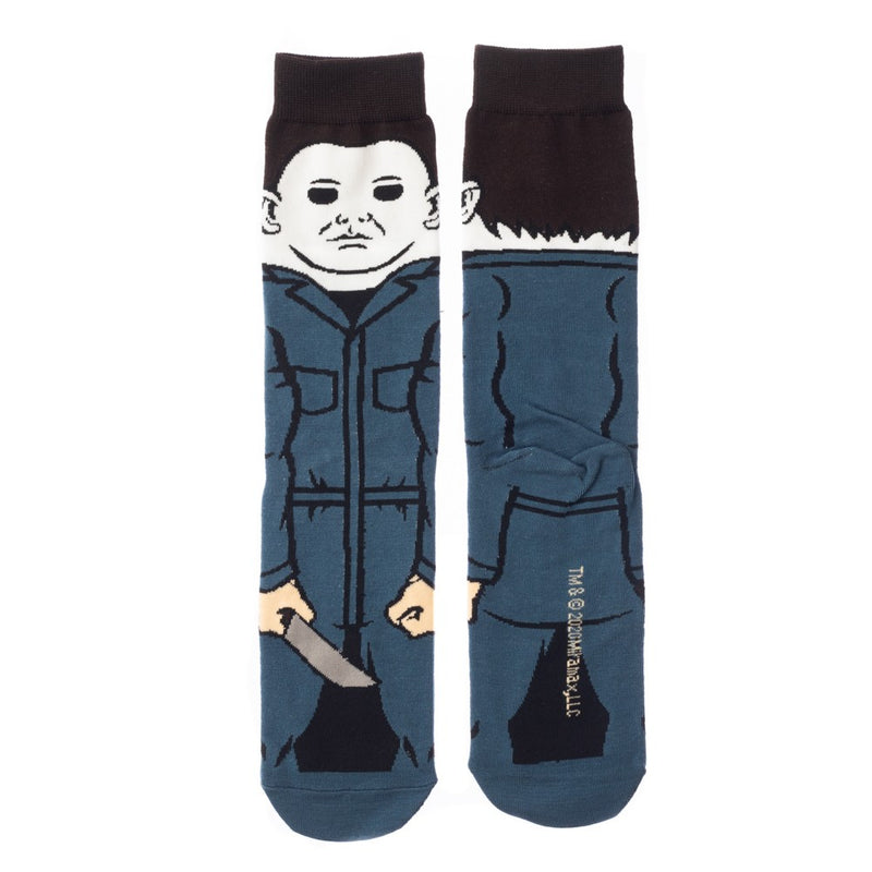 This is a pair of Halloween Michael Myers 360 crew socks and he has on blue overalls, a white mask with brown hair and is holding a knife.