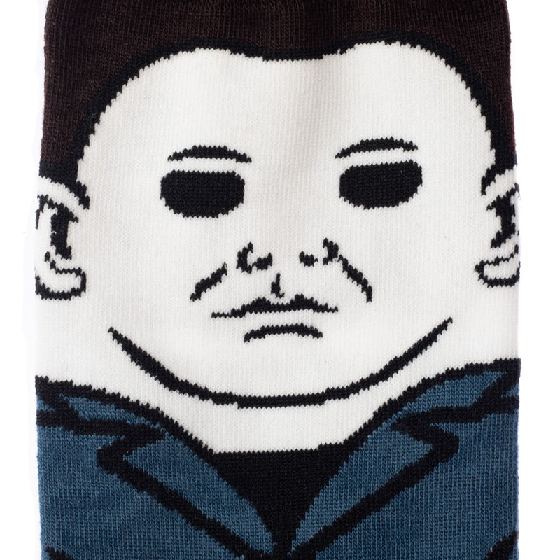 This is a close up of a pair of Halloween Michael Myers 360 crew socks and he has on blue coveralls, a white mask and has brown hair.