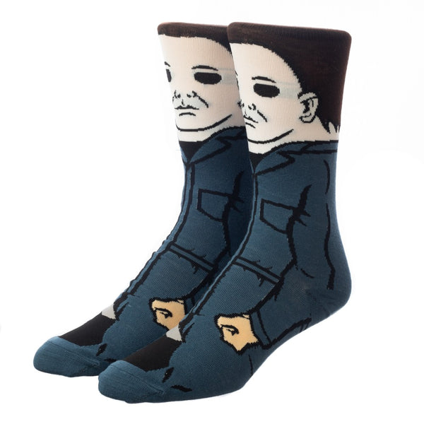 This is a pair of Halloween Michael Myers 360 crew socks and he has on blue coveralls, a white mask and has brown hair.