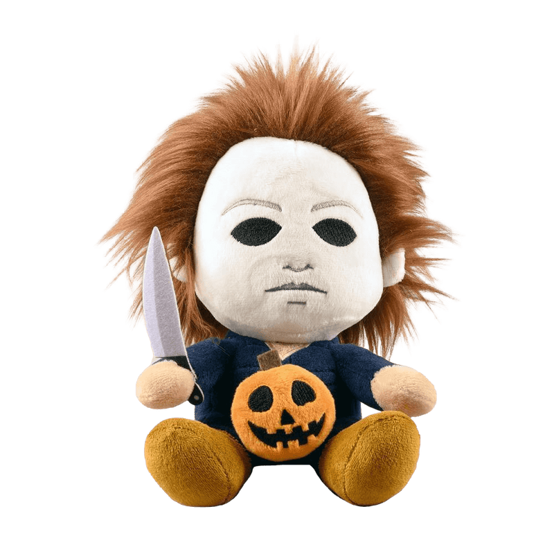 This is the front of a Kidrobot Halloween Michael Myers Phunny stuffed plush that has a white face, brown hair, blue coveralls, a silver knife and orange pumpkin.
