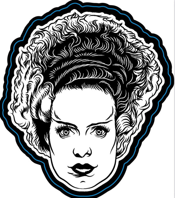 This is a Universal Monsters Bride of Frankenstein face die cut magnet and she has black and white hair.