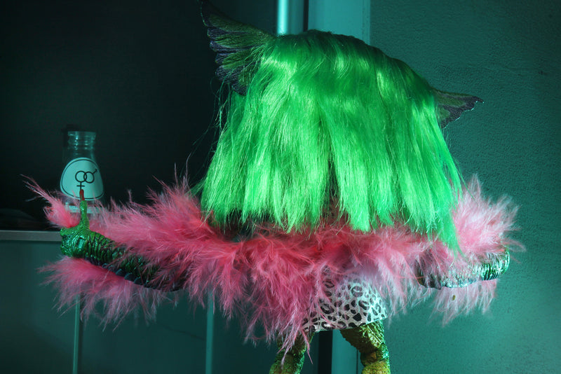 "This is a NECA Gremlins 2 Greta 7"" Ultimate action figure and she has long green hair, a pink boa and long red nails."