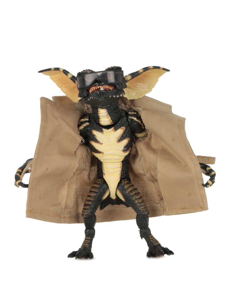 This is a NECA Gremlins flasher ultimate action figure with tan trench coat and glasses.