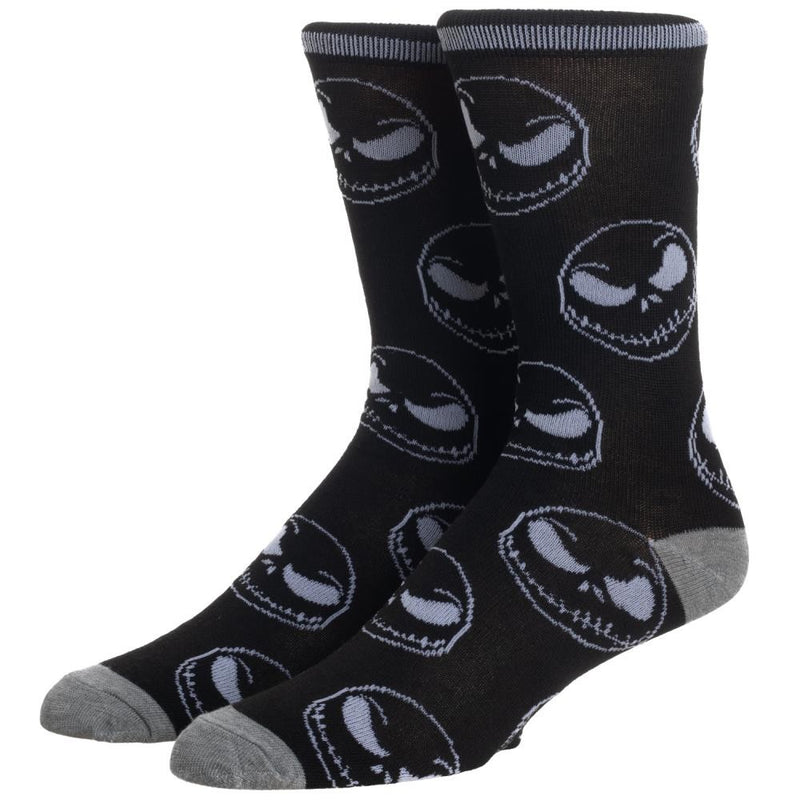 This is a pair of Nightmare Before Christmas Jack Skellington crew socks that are black with grey skull faces.