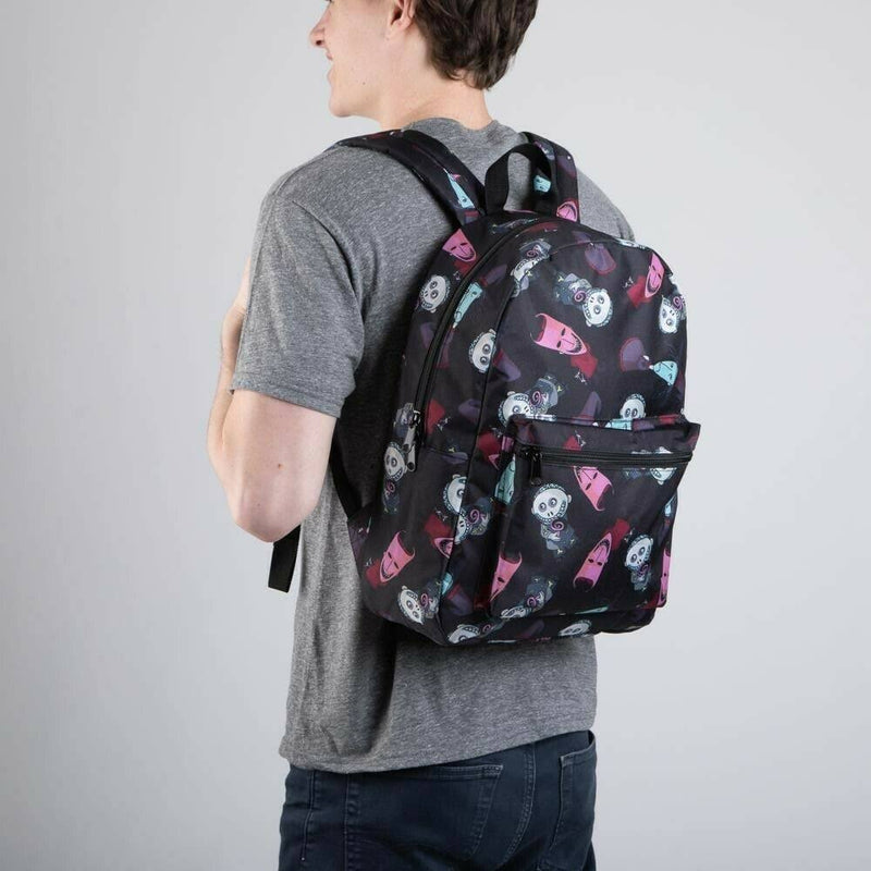 This is a Nightmare Before Christmas Lock Shock and Barrel backpack that is black, with a black handle, with a front zipper pocket, padded should straps and is on a guy wearing a grey shirt.