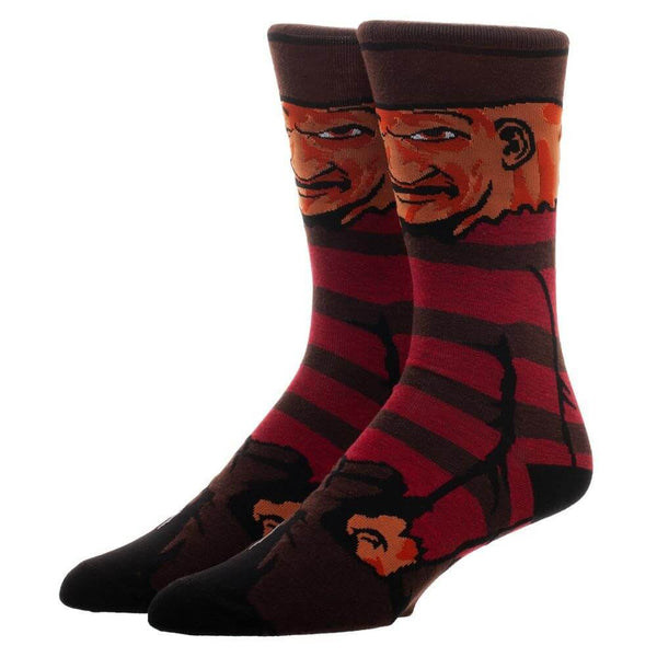 This is a pair of Nightmare On Elm Street Freddy Krueger 360 printed crew socks and he has a burnt face, brown hat and a brown and red sweater.