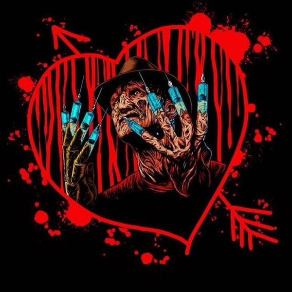 This is a Nightmare On Elm Street Freddy heart sticker and he has a burnt face, brown hat and syringes for fingers.