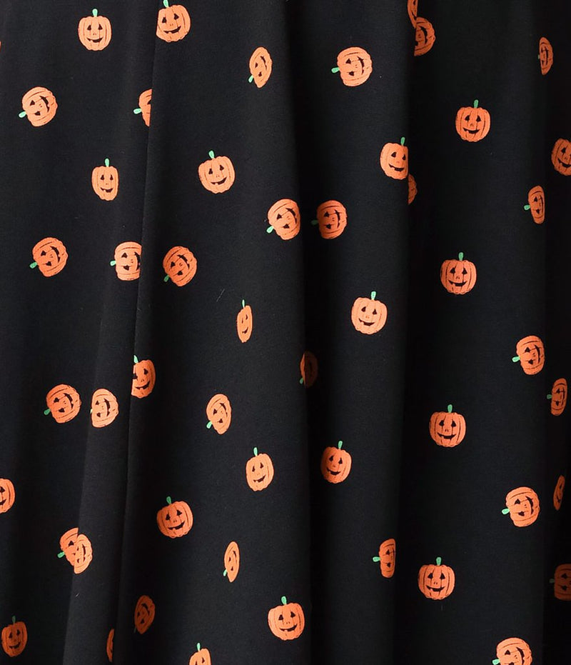 This is a black pinup flare dress with orange pumpkin print.