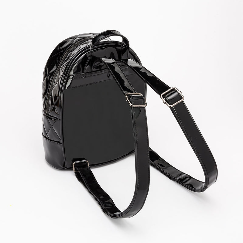 This is a vegan black Universal Monsters purse backpack that is shiny and has straps to wear on your back or a handle.
