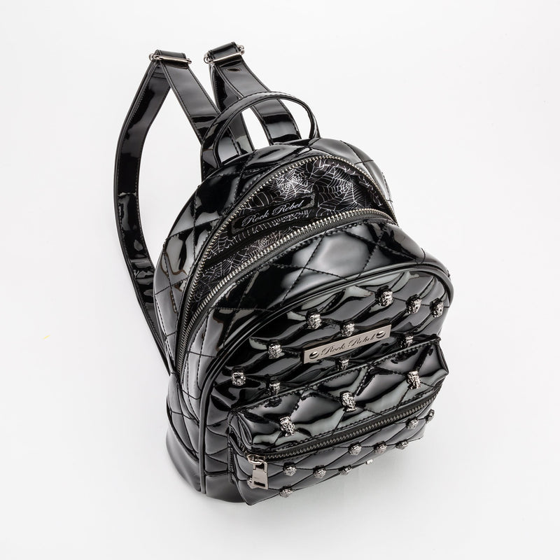 This is a vegan black Universal Monsters purse backpack that is shiny and has cobweb lining on the inside.