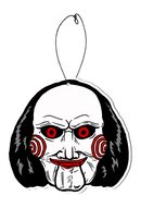 This is a Saw Billy puppet air freshener that has a black suit with red bowtie, white face with spirals, black hair and an elastic hanger.
