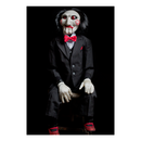 This is a Saw movie Billy puppet prop by Trick Or Treat and he is wearing a black suit, red shoes, with a red bow tie and has red eyes, lips, black hair and bullseyes on his cheeks.