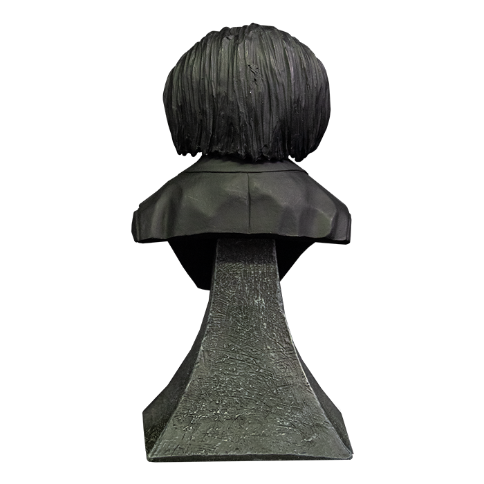 This is a Saw Billy mini bust and he has black hair, black suit and he is on a grey stand.