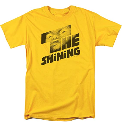 This is a Shining poster t-shirt and it is yellow with black letters and there is a scary face in the T.