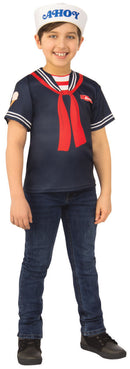 This is a Steve Scoops Ahoy Stranger Things costume and it is a white hat that says ahoy in blue letters and a blue shirt with red tie, with a Steve name tag.