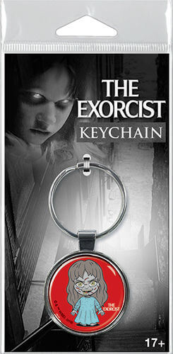 This is a keychain of Regan from The Exorcists and she is standing in a blue nightgown.