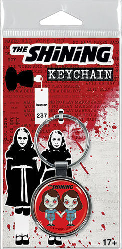 This is a The Shining Grady Twins keychain and it is red with the twins wearing blue dresses.