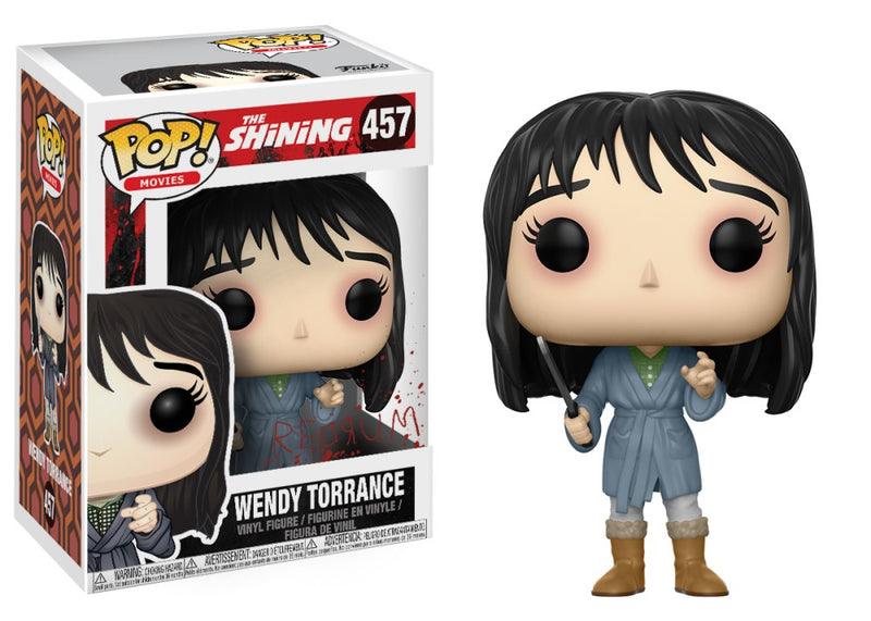 Wendy Torrance from the Shining in the form of a pop vinyl funko and she has brown hair, a blue outfit and is holding a knife.
