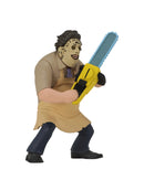Leatherface NECA is standing in front of a white background wearing a killing mask, while wearing a yellow apron and holding a yellow chainsaw.