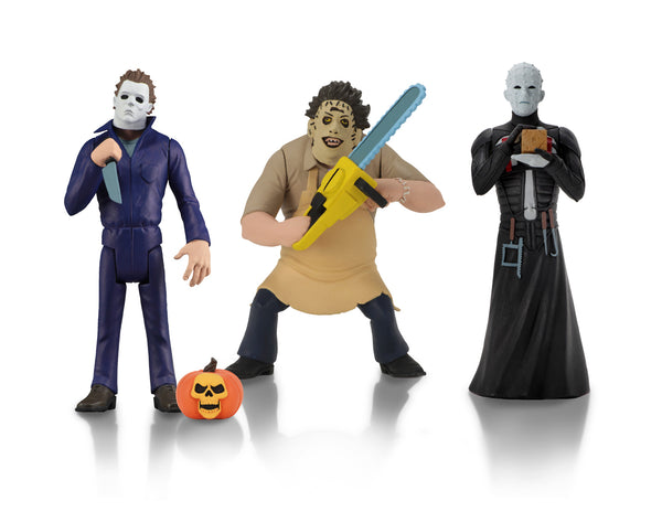 Michael Myers is holding a knife and has a pumpkin at his feet, while Leatherface is holding a yellow chainsaw and wearing a yellow apron and Pinhead is standing in a black dress, while holding a brown box.