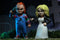 Chucky NECA action figure is holding a knife and standing next to Tiffany, who is holding a cigarette.