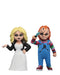 Chucky NECA action figure is wearing a striped shirt with coveralls, holding a knife and standing next to Tiffany in a white wedding dress, who is holding a cigarette.