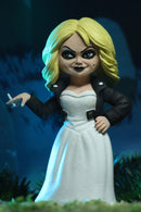 Tiffany NECA action figure Toony Terror is in a white wedding dress and black leather jacket, and holding a cigarette.