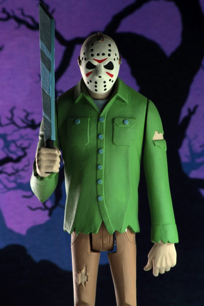 "This is a Friday the 13th Jason Voorhees posable NECA 6"" action figure, who is holding a machete and wearing a green shirt, brown pants and a white hockey mask."