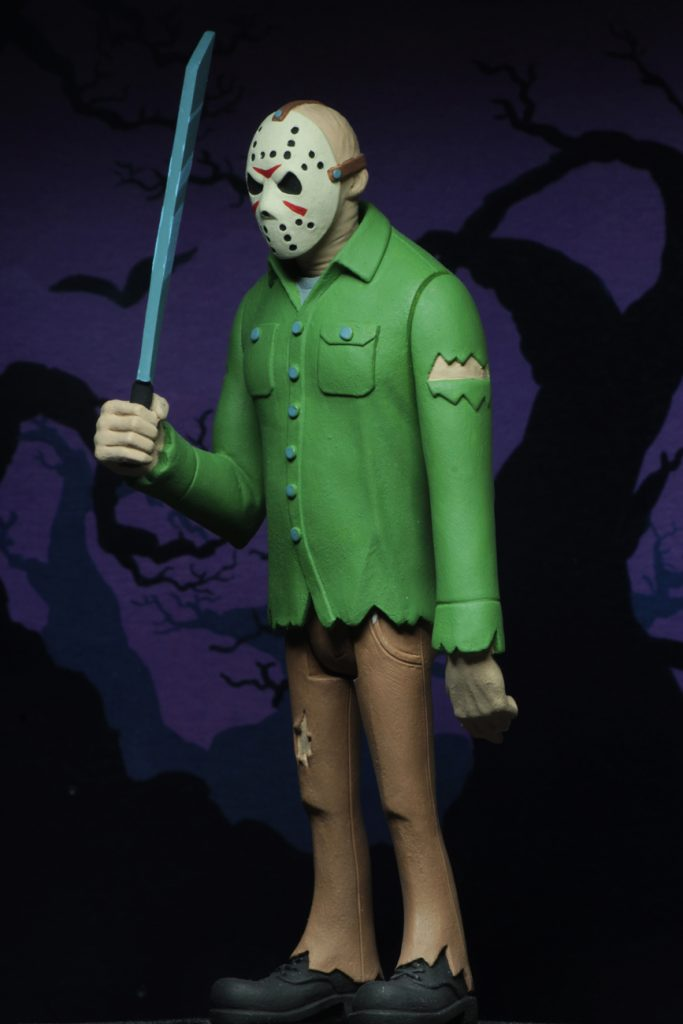 This is a NECA Toony Terror action figure of Friday the 13th Jason Voorhees, who is wearing a hockey mask, green shirt, brown pants, boots and holding a machete.