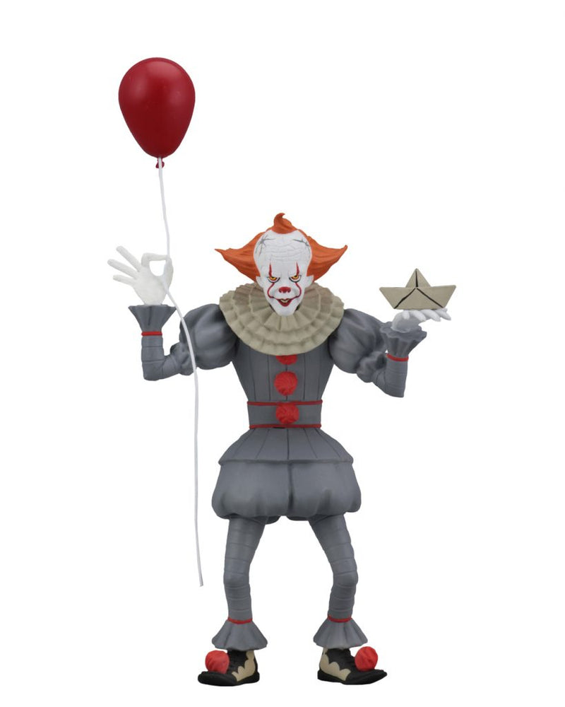 This is a NECA Toony Terrors It 2017 Pennywise action figure and he is wearing a grey clown suit that has three red balls and a white collar, with white gloves, balls on his shoes, a white face and orange hair and is holding a red balloon.