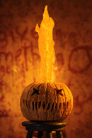 "This is a Trick R Treat Sam NECA 7"" ultimate action figure and there is a on orange pumpkin on a stool with the teeth and eyes cut out and fire coming out of it."