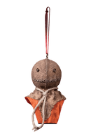 This is a Trick 'r Treat Sam ornament and he is wearing a burlap mask with button eyes and an orange jumpsuit and he has a string to hang.